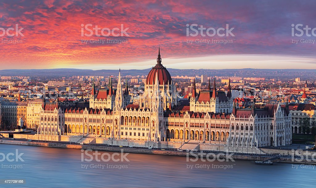 Budapest parliament at dramatic sunrise stock photo