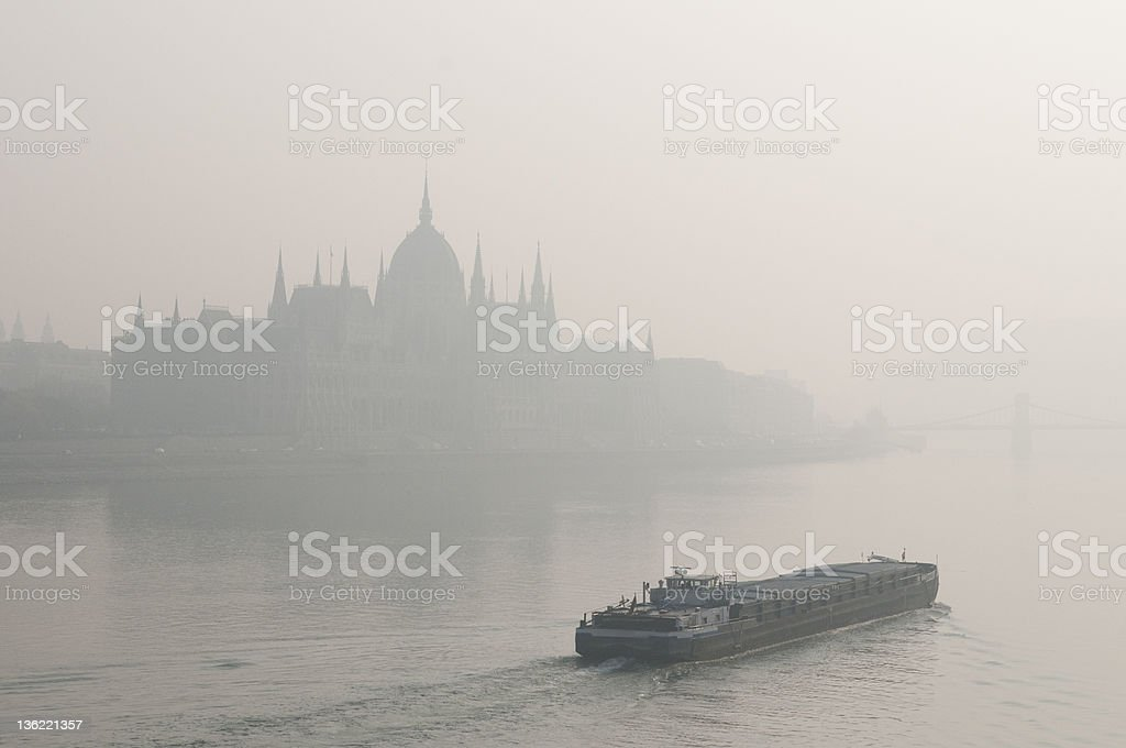 Budapest parliament in smog with a ship royalty-free stock photo