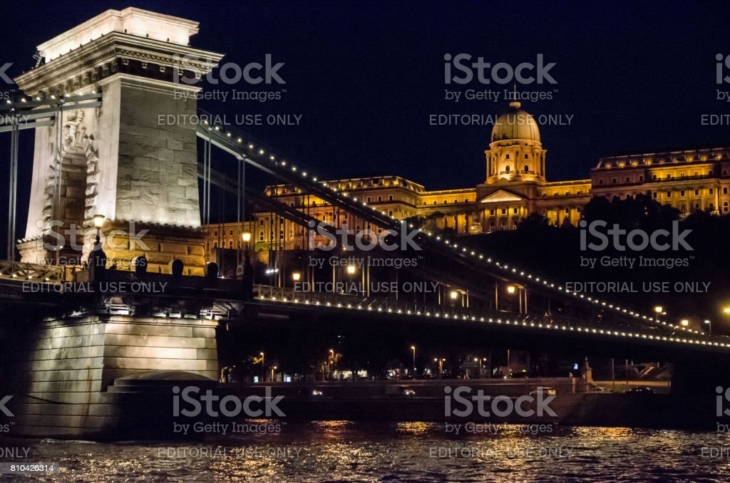 Budapest Szechenyi Chain Bridge over Danube river with Buda Castle in background at summer night stock photo