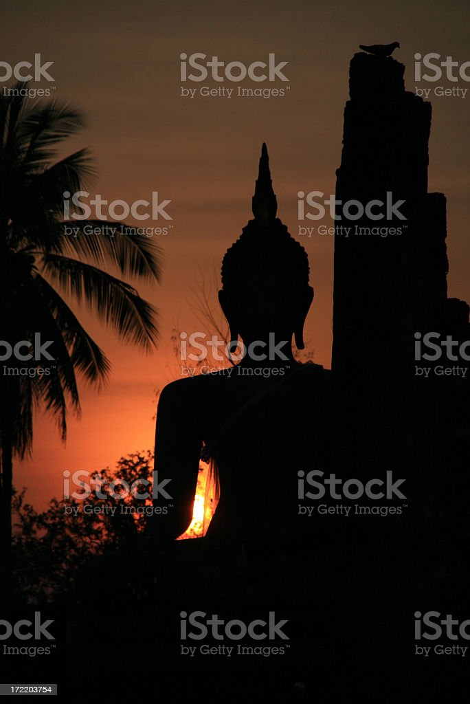 Buddha and Buddhist Temple in Sukhothai at Sunset royalty-free stock photo