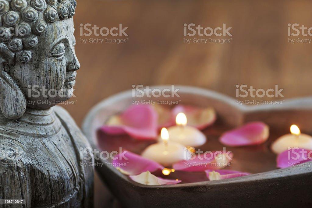 buddha and candlelights stock photo