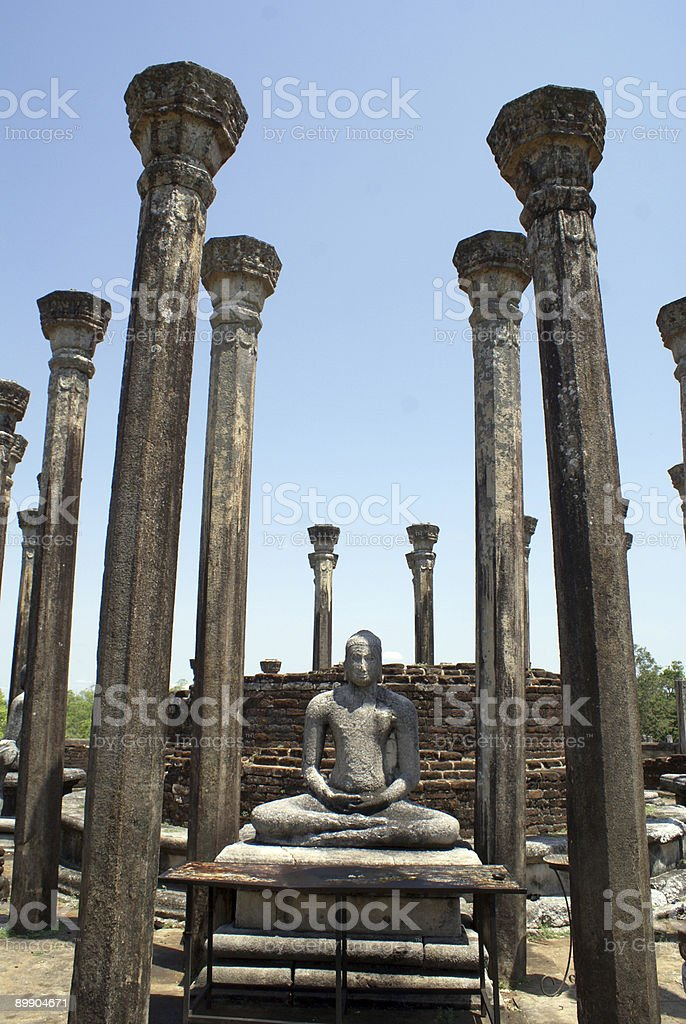 Buddha and pillars royalty-free stock photo