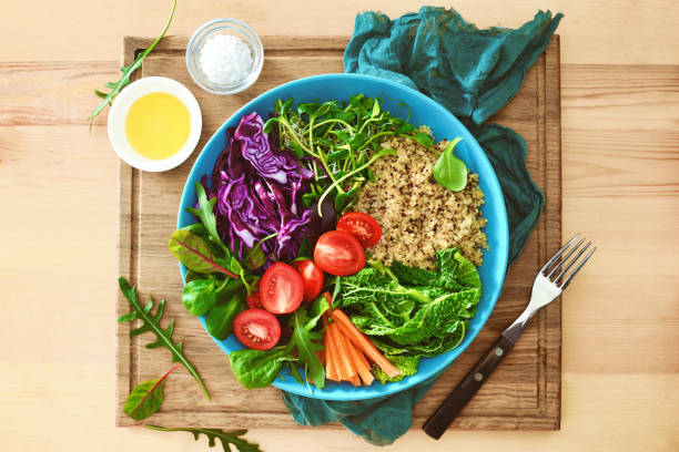 Buddha bowl meal, overhead view Buddha bowl meal with kale, quinoa and fresh green sprouts, overhead view anti inflammatory stock pictures, royalty-free photos & images