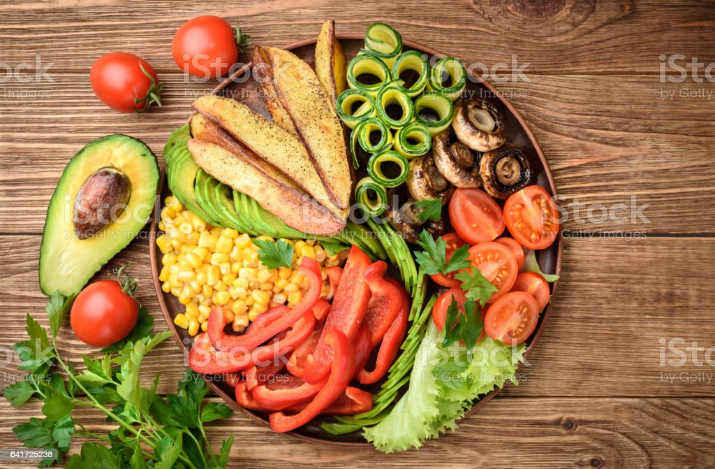 Buddha bowl of mixed vegetable on the wooden table. stock photo
