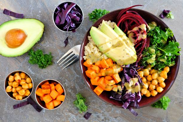 Buddha bowl on a stone background. Healthy eating, overhead scene. stock photo