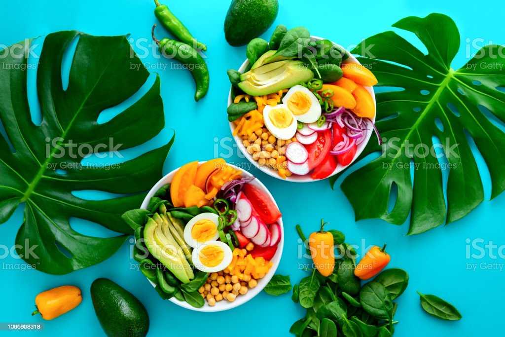 Buddha bowl salad served on monstera leaves royalty-free stock photo