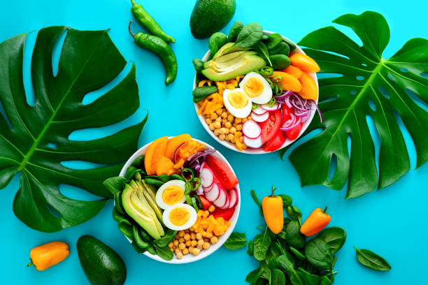 buddha bowl salad served on monstera leaves - fashionable stock pictures, royalty-free photos & images