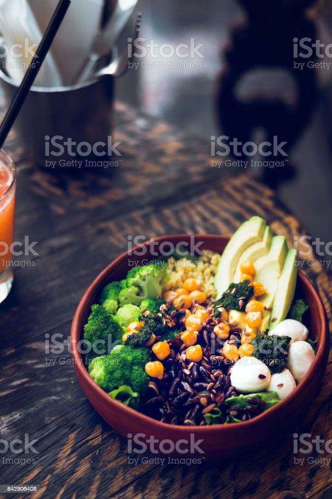 Buddha bowl vegetarian salad on wooden table stock photo