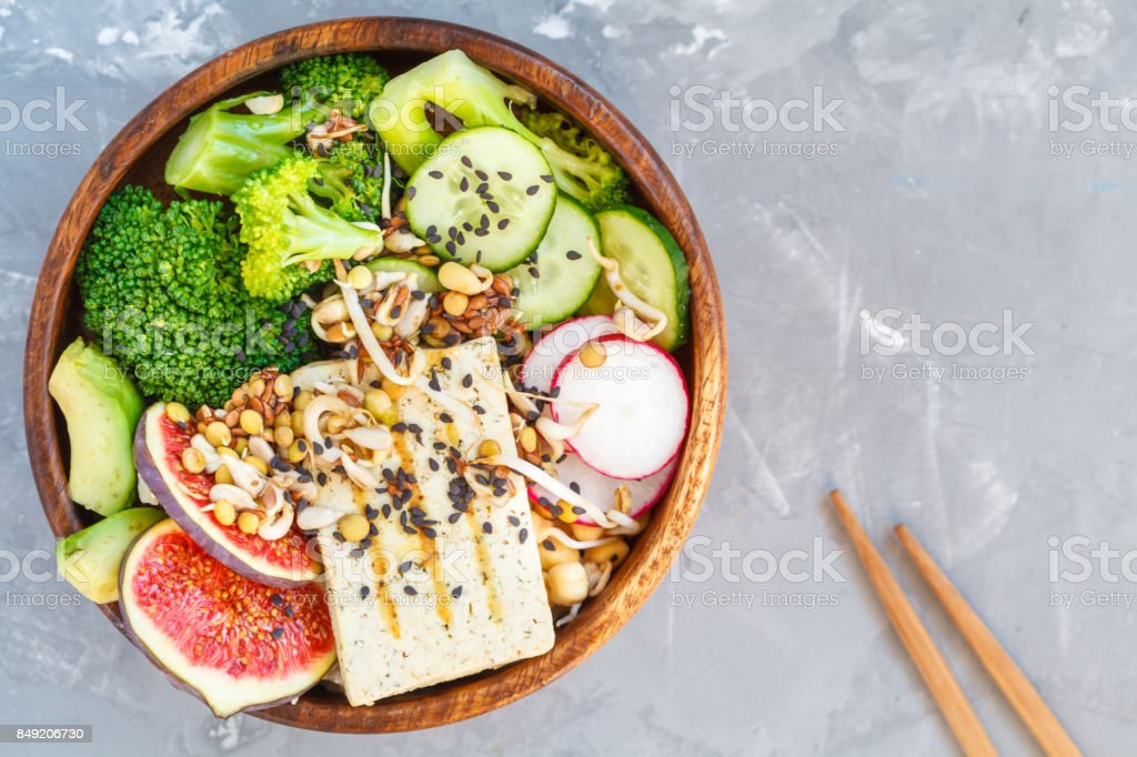 buddha bowl with tofu, broccoli and vegetables stock photo