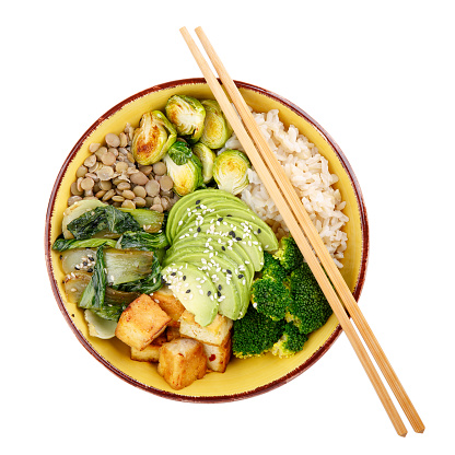 Buddha bowls isolated on white background. Colorful bowls with vegetables, healthy grains, and protein. Rice, lentils, tofu, avocado, broccoli, brussels sprouts, bok choy, sesame seeds. Healthy vegan food, vegetarian food concept. Top view.