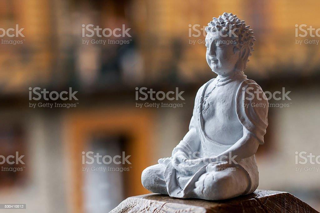 Buddha ceramic statue.  Yoga, buddhism, meditation background with empty space stock photo