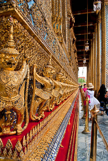Buddha detailing at the Temple of the Emerald Buddha stock photo