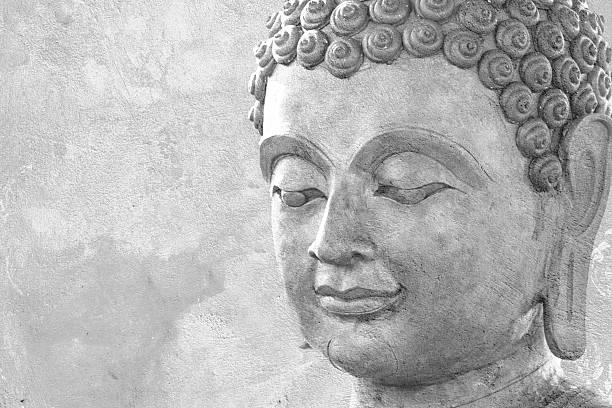 buddha face by wax stock photo