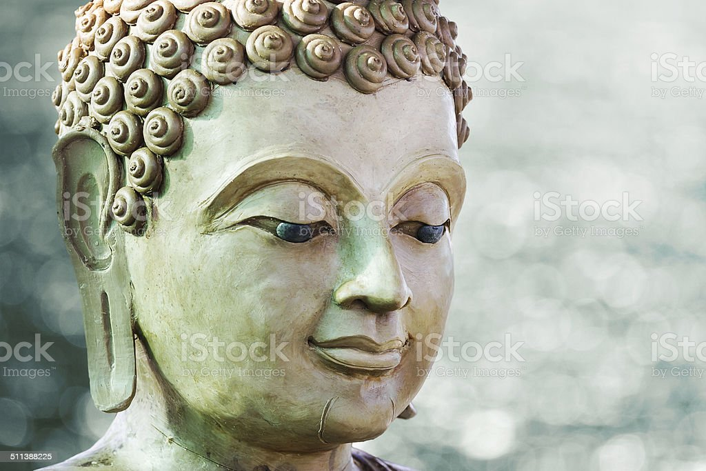 buddha face by wax stock photo