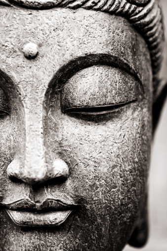 Close up view of generic Buddha's face. Taken in studio.