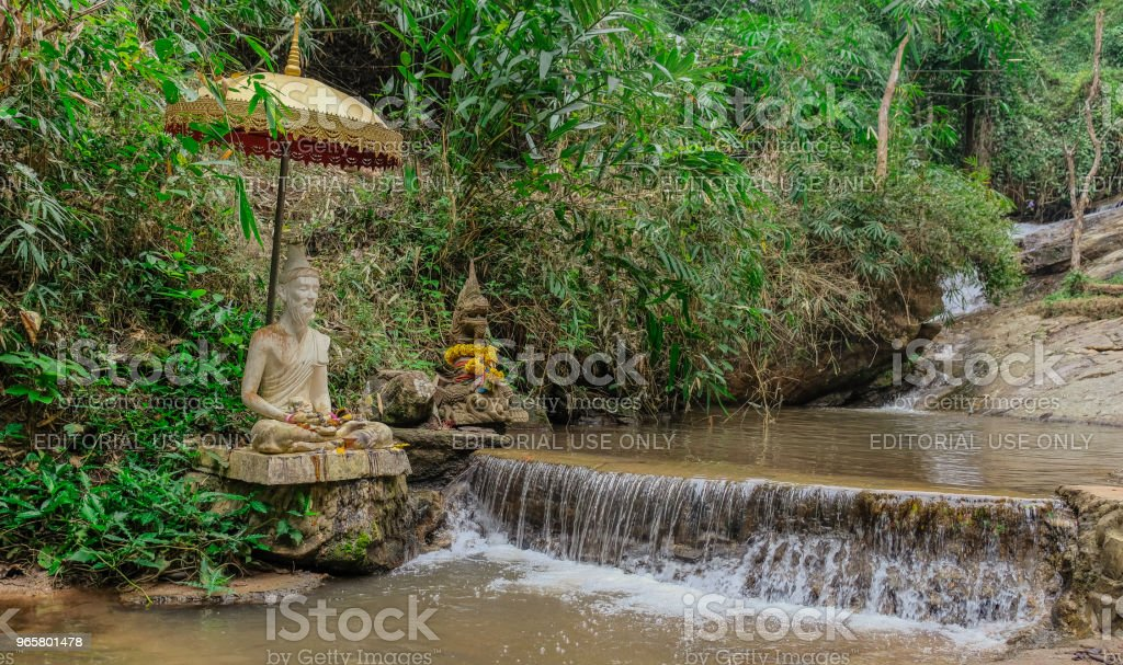 Buddha figure in a river - Royalty-free Ancient Stock Photo