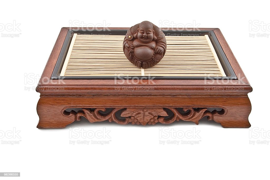 Buddha figurine on chinese wooden table royalty-free stock photo