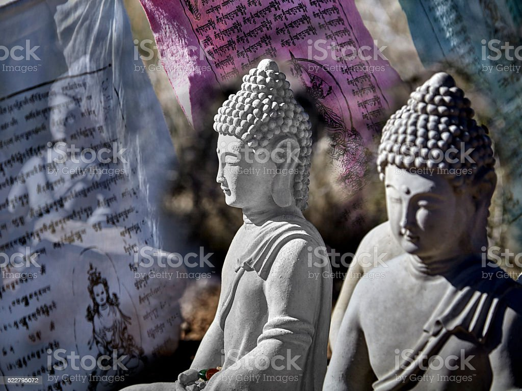 Buddha Figurines sitting in Meditation stock photo