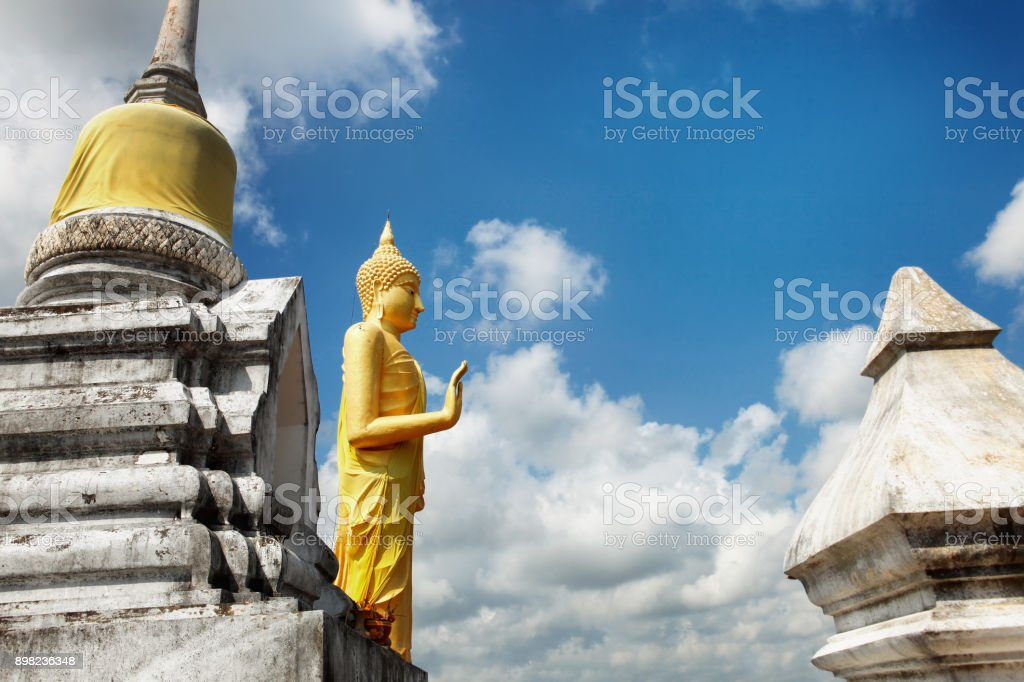 Buddha gold statue at Wat Khao Chedi-Phra Yai temple located on top of hill, Pathio, Chumphon district, Thailand stock photo