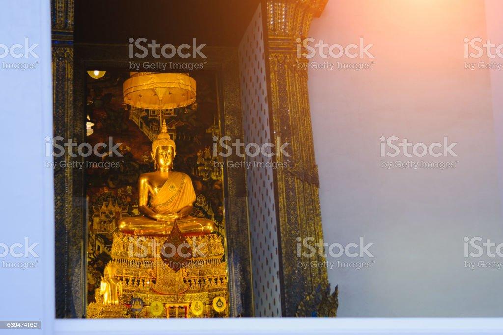 Buddha gold statue with thai art architecture. stock photo