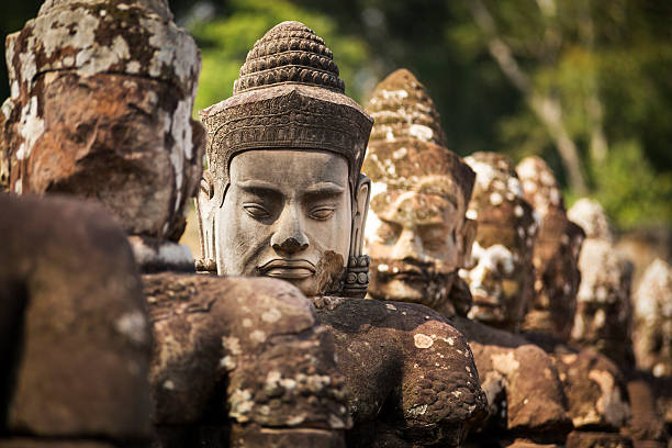 Buddha head in Angkor Wat Heritage site in Cambodia stock photo