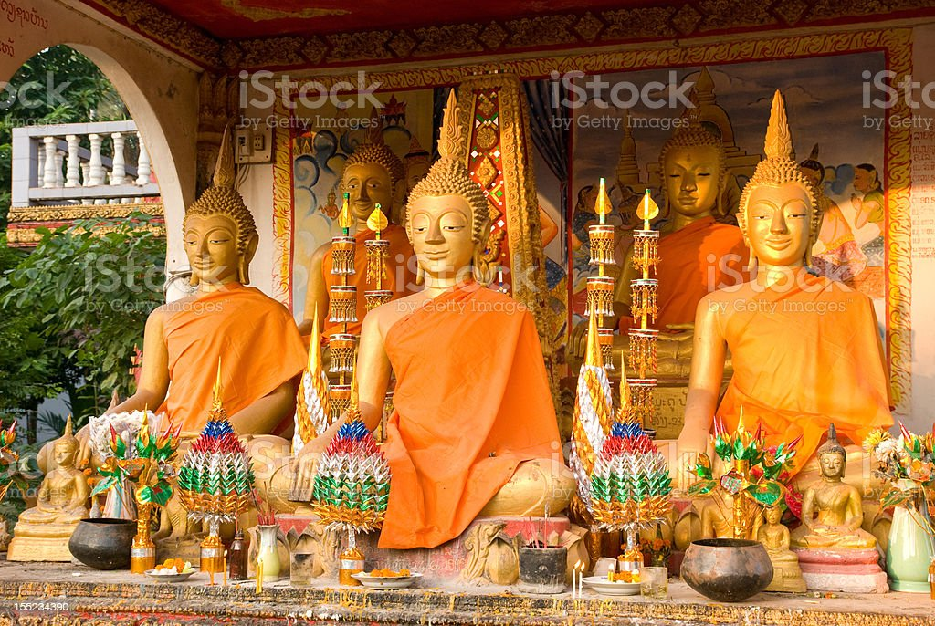 Buddha images at Wat That Luang in Vientiane stock photo