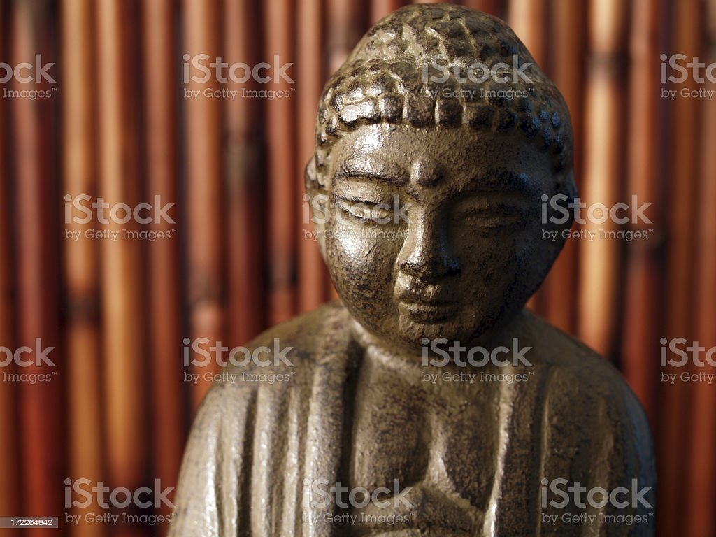 Buddha in front of bamboo royalty-free stock photo