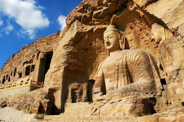 Buddha of Yungang buddhist caves in Shanxi, China. stock photo