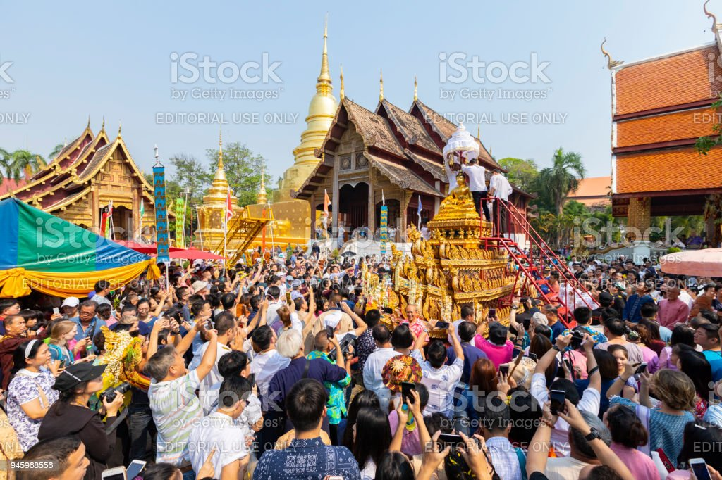 Buddha Phra Singh of Phra Singh temple was moved to the parade cars for pour water in Songkran festival stock photo