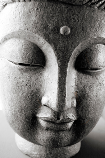 Buddha face on the desk.