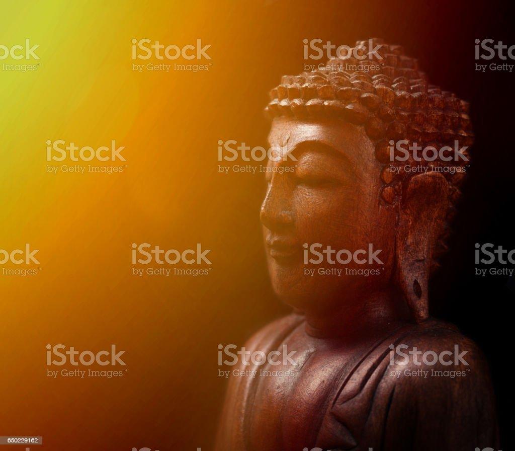 Buddha portrait against dark background stock photo