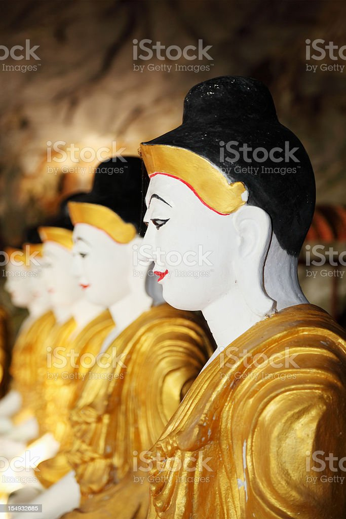 buddha portraits in cave temple royalty-free stock photo
