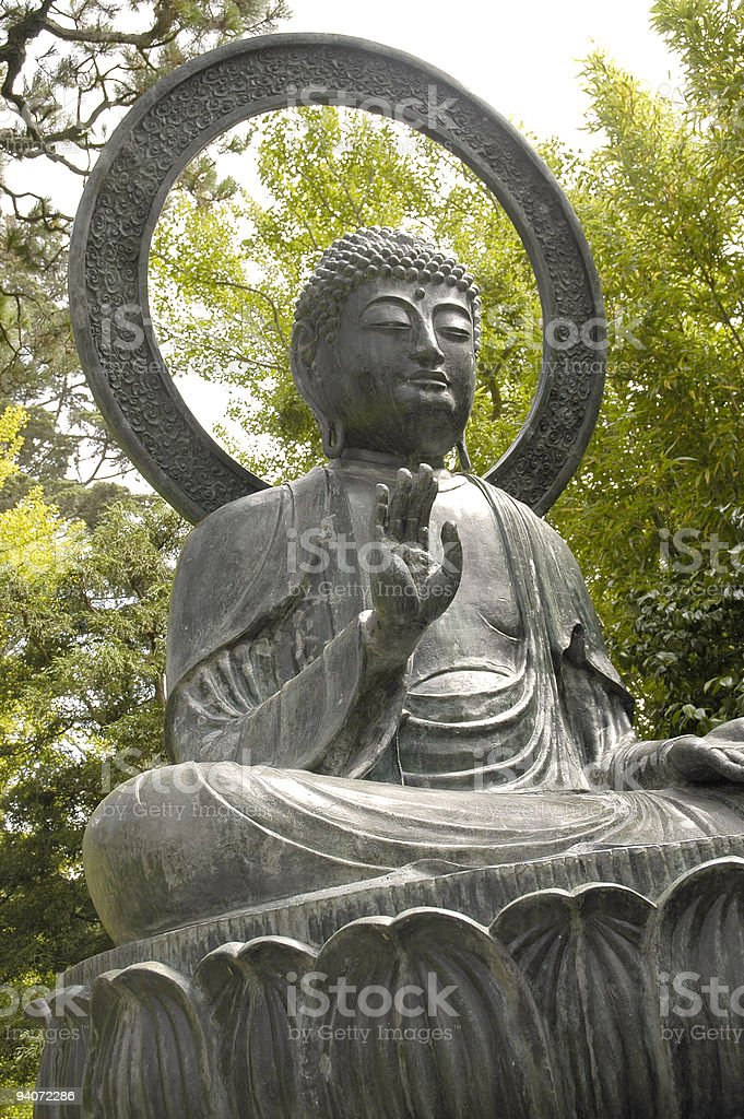 Buddha sculpture viewed from low angle royalty-free stock photo