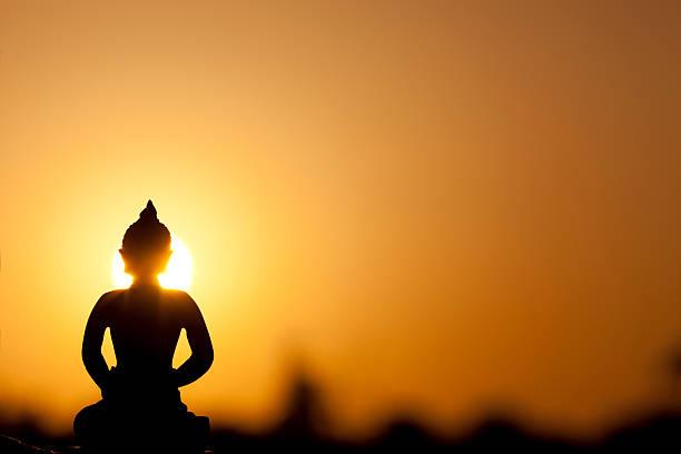 buddha silhouette and real sunrise stock photo