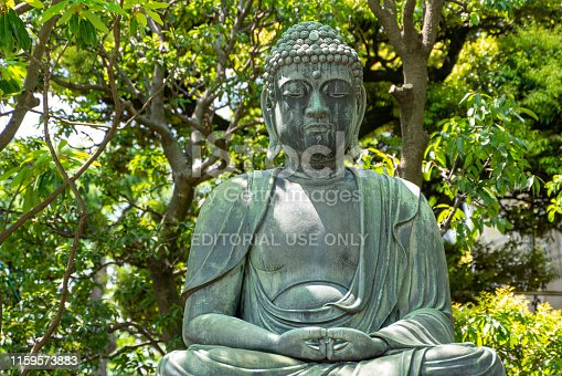 Tokyo, Japan - May 05, 2019: Buddha sitting on a lotus flower at the Sensoji Temple (Asakusa Kannon Temple) in the Asakusa district in Tokyo. Buddha is Emblem of spirituality, and the place and the environment are very zen.