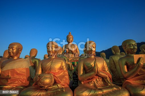 istock buddha statue against clear blue sky in thailand temple 859156642