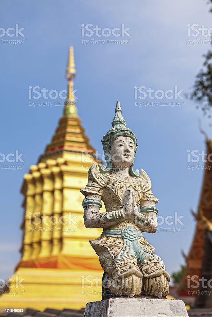Buddha Statue and Buddhist Temple With Blue Sky royalty-free stock photo