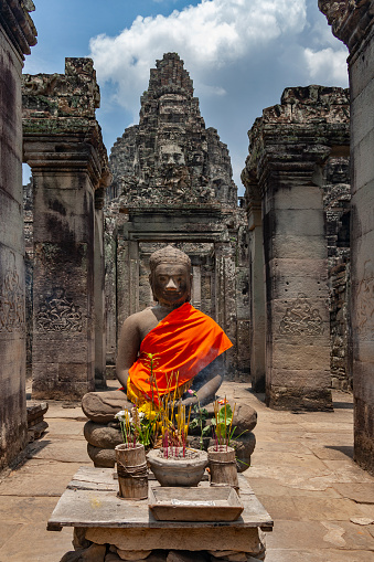istock Buddha statue and offering at the Bayon Temple - Angkor Wat - Cambodia 1191446738