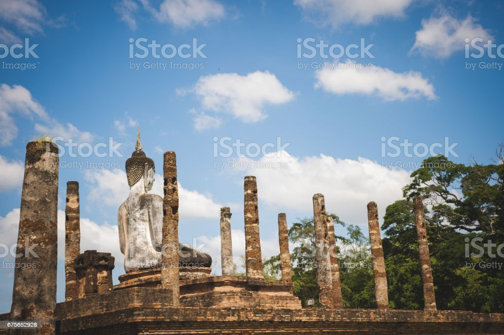 Buddha statue and pagoda in Sukhothai historical park, world heritage site in Thailand. royalty-free stock photo