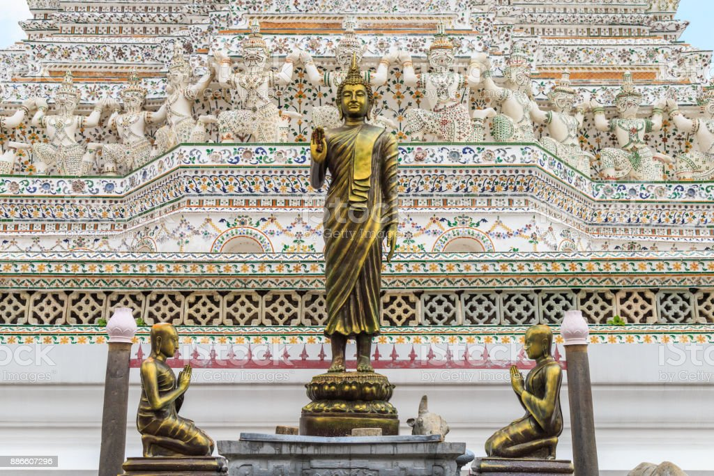 Buddha statue and statues of disciples at Wat Arun stock photo