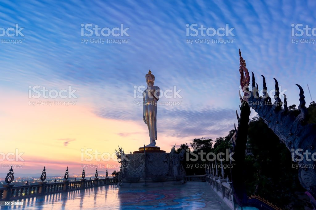 Buddha statue at peace stand at sunset Twilight color beautiful sky stock photo