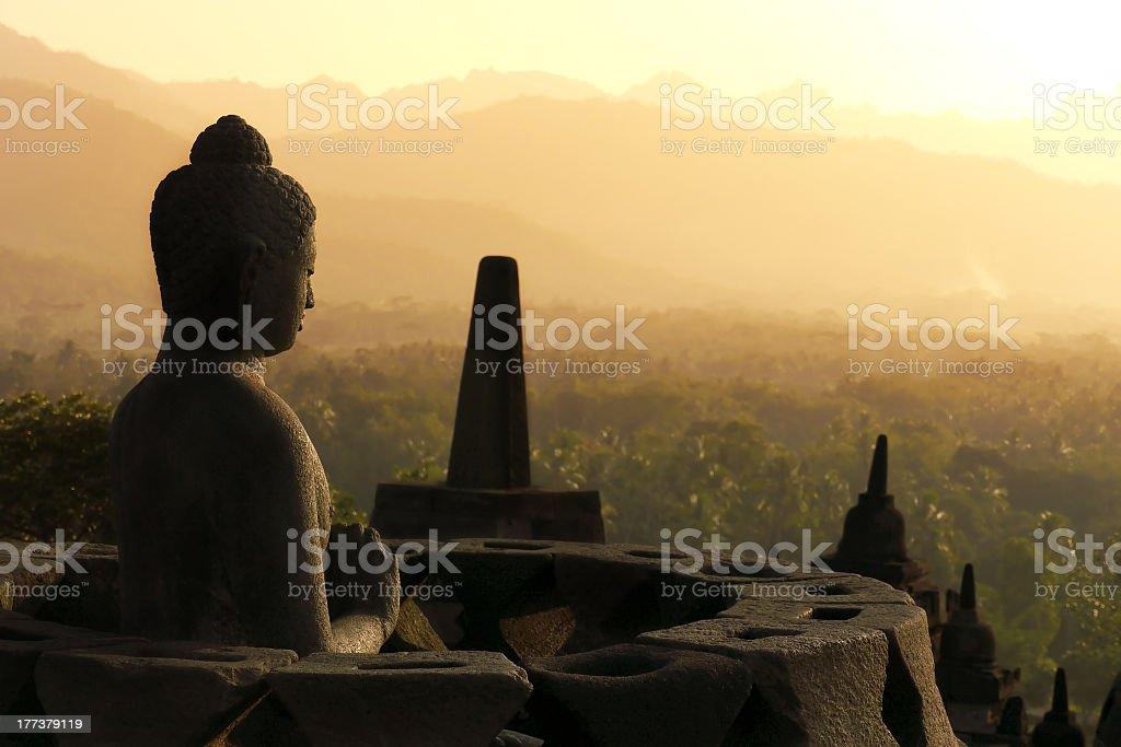 Buddha statue at sunset in Borobudur, Java, Indonesia stock photo