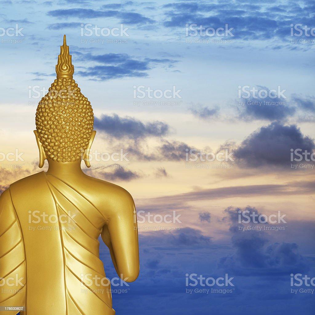 Buddha statue at sunset. Rear view. royalty-free stock photo