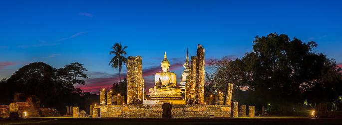 istock Buddha Statue at Wat Mahathat, buddha temple, in Sukhothai Thailand 670084162