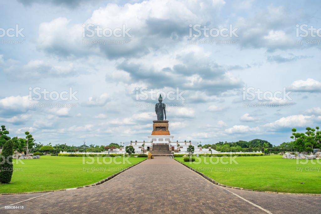 Buddha statue backside in decorated garden stock photo