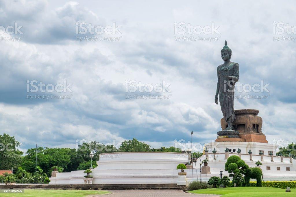 Buddha statue beside in decorated garden stock photo