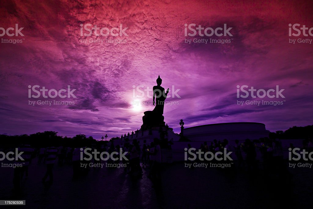 Buddha statue candle lit in lent day thailand stock photo