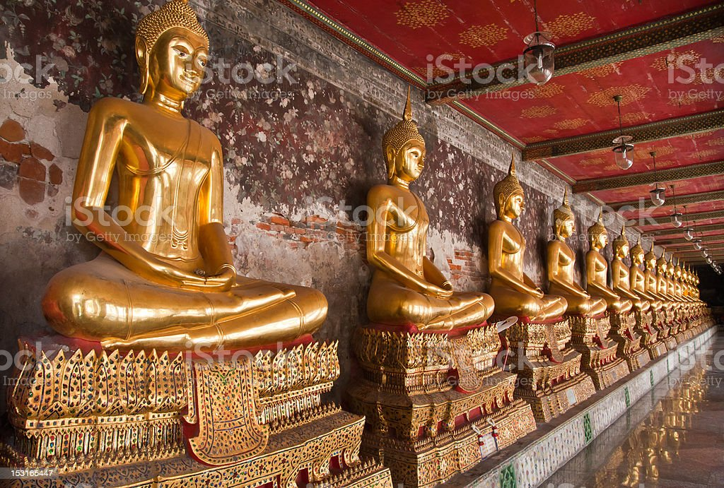 Buddha statue in a row tiled from right royalty-free stock photo