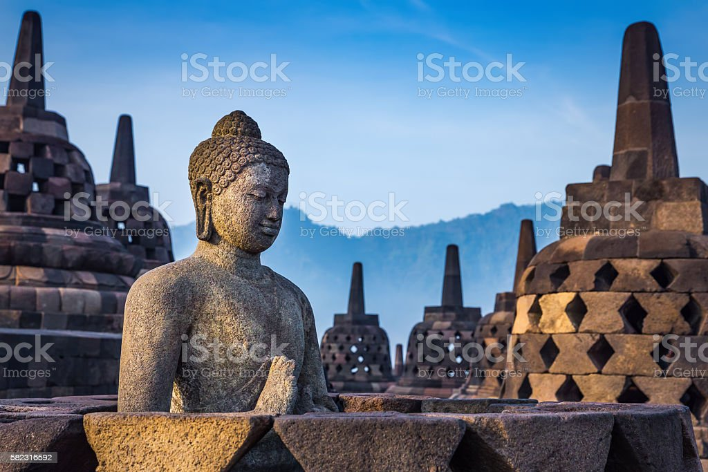 Buddha statue in Borobudur Temple, Java island, Indonesia. stock photo