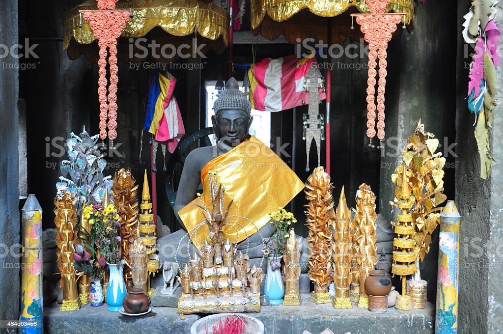 Buddha statue in Dhyana mudra mediation pose at Banteay Kdei stock photo